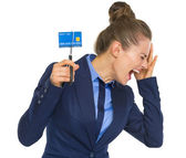 Business woman cutting credit card — Stock Photo