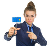 Business woman credit card squeezed — Stock Photo