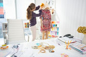 Fashion designer decorating garment — Stock Photo