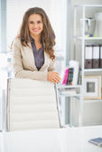 Happy business woman in office — Stock Photo