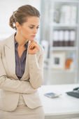 Thoughtful business woman in office — Stock Photo