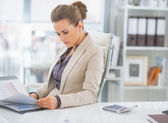 Business woman with documents in office — Stock Photo