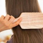 Woman combing hair — Stock Photo #47429879