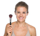 Woman showing makeup brush — Photo