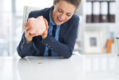 Business woman shaking out coin — Stock Photo