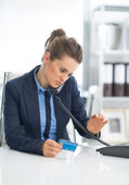 Business woman dialing phone — Stock Photo