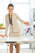 Business woman offering to sit — Stock Photo
