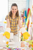Woman showing hand made pot holder mitts — Stock Photo