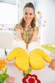 Woman showing easter hand made pot holder — Stock Photo