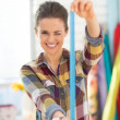 Happy seamstress using measuring tape — Stock Photo #47473019