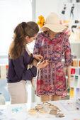 Fashion designer dressing mannequin in office — Stock Photo