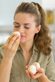 Housewife smelling mushroom — Stock Photo