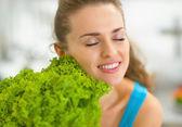 Woman enjoying fresh salad — Stok fotoğraf