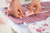 Seamstress making marks on fabric — Stock Photo