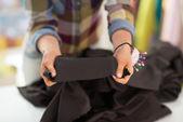Seamstress showing fabric — Stock Photo