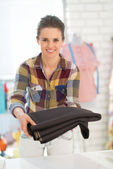 Seamstress showing fabric — Stock Photo