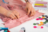Seamstress working with garment — Stock Photo