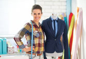 Seamstress near mannequin in suit — Stock Photo