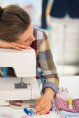 Seamstress sleeping on sewing machine — Stock Photo