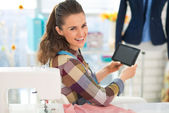 Seamstress using tablet pc at work — Stock Photo