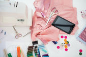 Seamstress table with tablet pc — Stock Photo