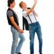Two teenage boys making photos on cell phone. Isolated on white — Stock Photo #8604974