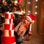 Surprised beautiful woman near Christmas tree — Stock Photo #8653300