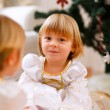 Two happy twins girl sitting with presents near Christmas tree — 图库照片 #8657877