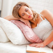 Young woman fell asleep while reading book — Stock Photo #8998629