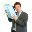 Modern businessman shaking present box trying to guess what's in — Stock Photo #8999646