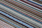 Front door carpet in various colored lines — Photo