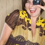 Woman and miniature camera. — Stock Photo #9280389