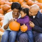 Family holding pumpkins. — Stock Photo #9307350