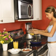 Attractive Young Woman in Kitchen Cooking Breakfast — Stock Photo #9365769
