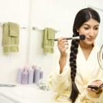 Young Woman Applying Makeup — Stock Photo #9367084