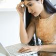 Concerened Young Woman Using Laptop — Stock Photo #9367136