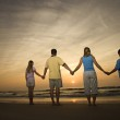 Family holding hands on beach — Стоковое фото #9498353