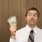 Man holding money. — Stock Photo #9530482