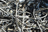 Automobile scrapheap pipework — Stock Photo