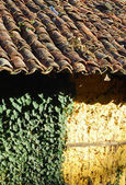 Adobe frame-build wall roof tiles — Stock Photo