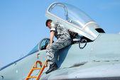 Military aircraft and pilot — Stock Photo