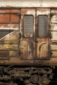 Old abandoned wagon grunge side — Stock Photo