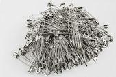 Safety pins pile closeup — Stock Photo