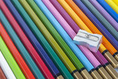 Used color pencils and sharpener — Stock Photo