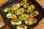 Field mushrooms in pan — Stock Photo