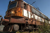 Abandoned electric locomotive — Stock Photo