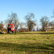 Tractor on farm meadow — Stock Photo