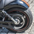 Stock Photo: Rear powerful motorcycle wheel