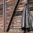 Stock Photo: Leather jacket on wooden wall