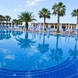 Water pool and chairs - vacation background - Stock Photo